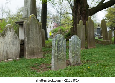 PRINCETON, NEW JERSEY - April 26, 2017: Old headstones mark graves at this historic cemetery, owned by the Nassau Presbyterian Church.