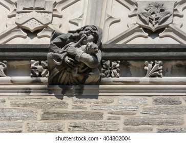 Princeton, New Jersey - October 20 2013: Detailed view of high reliefs at the top of famous Blair Arch in Princeton University campus.