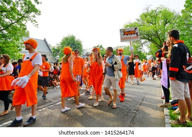 PRINCETON, NJ -1 JUN 2019- Princeton University alumni dressed in orange and black march joyously in the P-rade, the capstone of the New Jersey college's annual reunions.