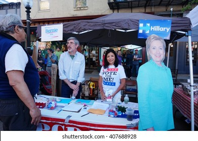 PRINCETON, NJ -17 APRIL 2016- Voters stop by a Democratic booth at a community fair in New Jersey with supporters of Bernie Sanders and Hillary Clinton. The NJ primary election is on June 7, 2016.