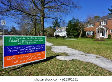 """PRINCETON, NJ -22 MAR 2017- A house displays a lawn sign written in English, Spanish and Arabic saying """"No matter where you are from, we're glad you are our neighbor"""" to protest Trump's policies."""