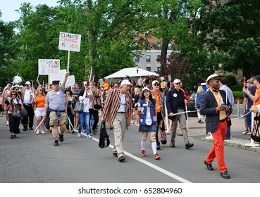 PRINCETON, NJ -3 JUN 2017- Princeton University alumni dressed in orange and black march joyously in the P-rade, the capstone of the New Jersey college's annual reunions.