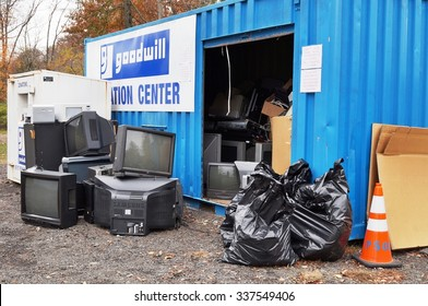 PRINCETON, NJ -6 NOVEMBER 2015- Old, obsolete, outdated electronics waste (screens, tv, computers, etc.) dumped in a junk pile to be recycled and disposed of at a Goodwill location.