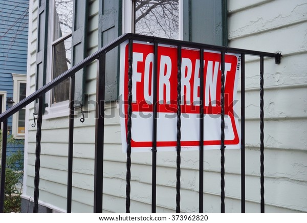 PRINCETON, NJ -8 FEB 2016- For Rent sign in the street. The property market in the United States has recovered from the 2008 housing crash, but there are vast regional differences in real estate.