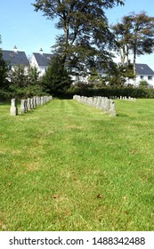 Princetown England August 2019. St Michael and All Angels. Commonwealth War Grave. Lines of headstones where prisoners are buried. Inscribed with Initials, date only.  last interment FSB 22.7.73