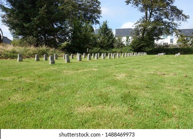 Princetown England August 2019. St Michael and All Angels. Lines of headstones where prisoners who had no relatives are buried. Inscribed with Initials, date only.  Last interment FSB 22.7.73