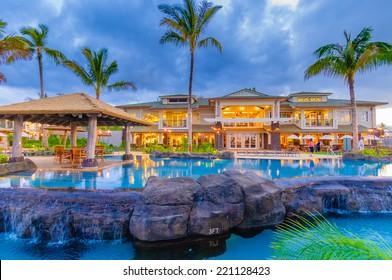 Princeville, Kauai, HI - April 24, 2008 - The Westin Resort pool and cabana at sunset in Princeville on the tropical island of Kauai in Hawaii, USA