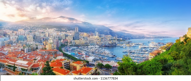 Principality of Monaco. Beautiful panoramic view on Monaco, golden hour scenery. View on apartment building, casino, great port with luxury yachts. Monaco is popular travel destination, wealth symbol.