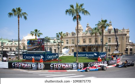 Principality of Monaco, May 12, 2018 - Vintage 1970s-era Formula 1 Grand Prix race cars round the curve in front of the Monte Carlo Casino at the Monaco Historic Grand Prix races.