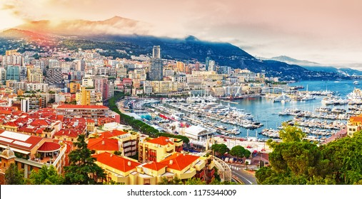 Principality of Monaco. Picturesque panoramic view on Monaco on sunset hour. View on apartment building, casino, port with luxury yachts. Monaco is popular travel destination for gambling. Landscape.
