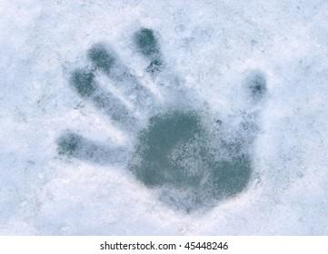 print of human palm on blue ice