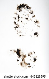 Print of muddy boot on a white clean surface, footprint, track