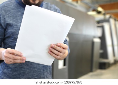 Print on the sheet. The man is watching the printout.