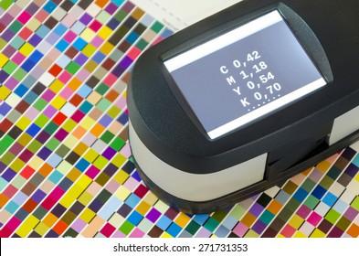 Print Spectrophotometer color measurement. Press offset color management cmyk values.