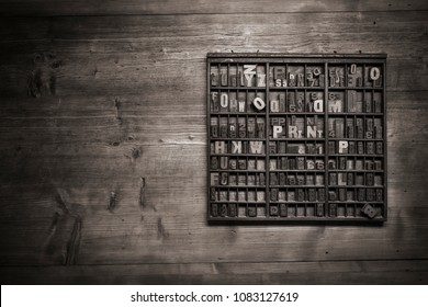 print still life with lettering, brushes and other tools on a wooden background