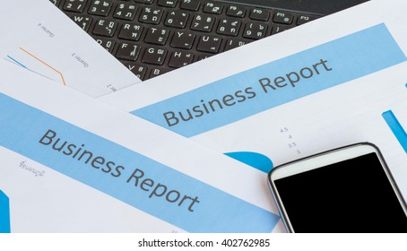 Printed Business Annual Report in Charts and smartphone .business concept.