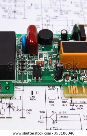 printed circuit board electrical components lying stock photo (editprinted circuit board with electrical components lying on construction drawing of electronics, drawings for engineer jobs, technology image