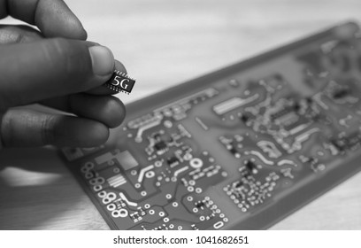 Printed Circuit Board with SMD & IC mounted part on board. 5G text on chips.