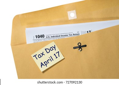 Printed copy of Form 1040 for income tax return for 2017 with reminder for April 17 deadline