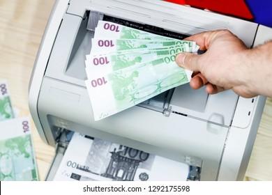 printed euro. home printer. concept crime fake money