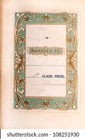 Printed insert dedicating a book as a first prize with an art nouveau style border on a pale green background.  About 100 years old.  Photo of whole page.  Room for your text.
