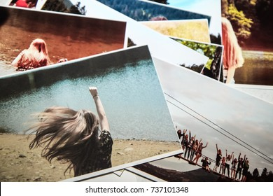 Printed photos. Girl Power concept. Sweet memories. The girl running forward with raised hand and fluttering hair. The way to success concept. Desire. Motivation concept