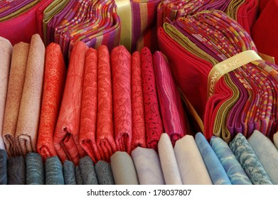 printed textile fabric sheets ordered by colors and in small bundles