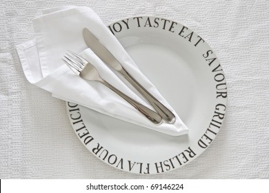Printed White China plate with serviette and cutlery