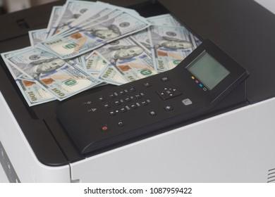 Printer and dollar bills