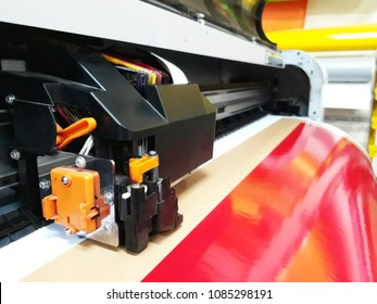Printer Head, large format digital printing, printer operating run on glossy pvc sticker(selective focus)
