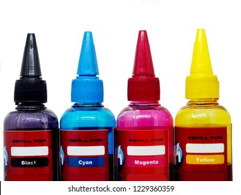 Printer ink refill, black, yellow, red and blue on a white background.