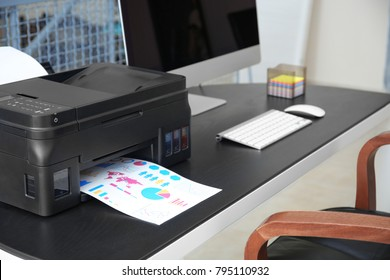 Printing document with diagrams in office, closeup