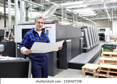 Printing house. The printer works in a modern production hall.