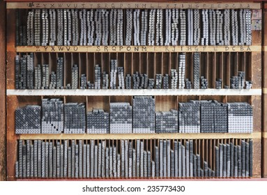Printing press letter blocks in a wooden shelf Printing industry