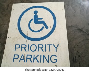 Priority parking sign. Parking area fordDisability.