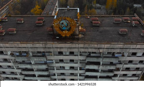 Pripyat aerial panorama cityview over the sign of USSR on the roof of building. Soviet coat of arms on a high-rise building in Pripyat, view from above.