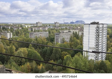 Pripyat and the old and new Chernobyl reactor shelters seen from the highest building in Pripyat