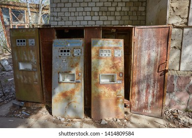 PRIPYAT, UKRAINE - April 25 2019: Rusty vending machines for sale soda water near cafe in dead abandoned ghost town of Pripyat, Chernobyl NPP exclusion zone, Ukraine