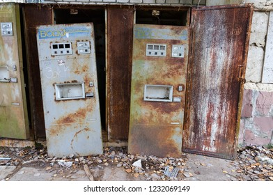 PRIPYAT, UKRAINE - NOVEMBER 11, 2018: Rusty machines for sale of sparkling water near cafe in abandoned ghost town of Pripyat, Chernobyl NPP exclusion zone, Ukraine
