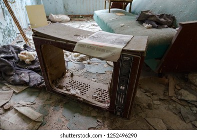 "PRIPYAT, UKRAINE - NOVEMBER 11, 2018: Frame of old TV ""Slavutich"" on floor among trash in rest room in hospital No. 126, dead ghost town of Pripyat in Chernobyl NPP alienation zone, Ukraine"
