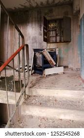 "PRIPYAT, UKRAINE - NOVEMBER 11, 2018: Old broken gas stove ""Electra 1001"" on staircase in 9-floor apartment building in abandoned ghost town of Pripyat, Chernobyl NPP alienation zone, Ukraine"