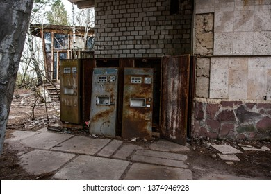 PRIPYAT, UKRAINE - NOVEMBER 11, 2018: Rusty vending machines for sale soda water near cafe in dead abandoned ghost town of Pripyat, Chernobyl NPP exclusion zone, Ukraine