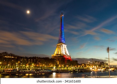 Pris, France-November 18, 2015 : The Eiffel tower lit up with the colors Of the French national flag (Blue, White and Red)to honor the victims of November 13 Friday's terrorist attacks in Paris.