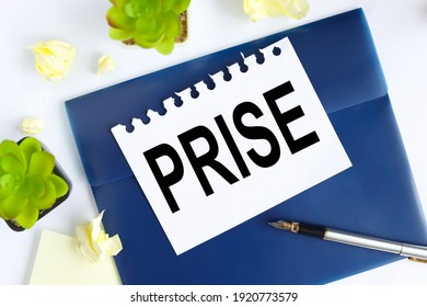 PRISE. Financial concept. text on white notepad paper on blue folder. on a light background near the crumpled stickers and plants. - Shutterstock ID 1920773579