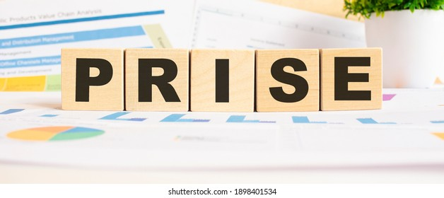 PRISE word on wooden cubes. The background is a business graphs. Finance concept - Shutterstock ID 1898401534