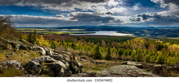 Prisecnice dam in Krusne hory mountains, Roots in the water tank Prisecnice, the best photo, Jeleni mountain. - Shutterstock ID 1593474892