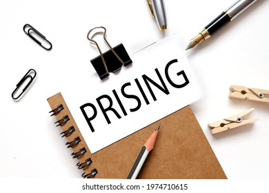 prising. the inscription on the business card is attached to the notebook. - Shutterstock ID 1974710615