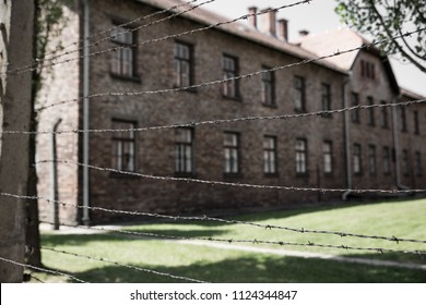 Prison barracks behind barbed wire wall