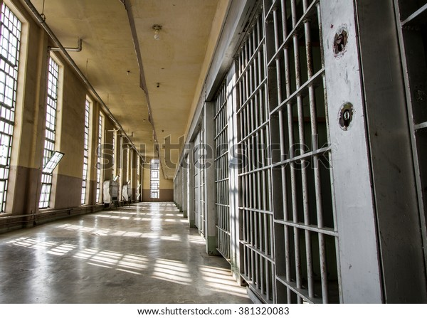 Prison bars and a hallway