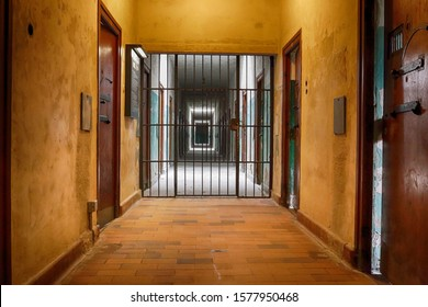 Prison corridor with grating oppressive